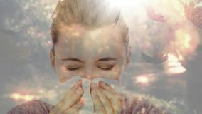 Falling autumn leaves and woman sneezing while suffering from allergy. Digital composite video of falling autumn leaves and woman sneezing while suffering from stock video footage
