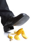 Falling on a banana skin Royalty Free Stock Image