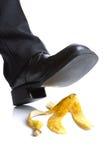 Falling on a banana skin Royalty Free Stock Image