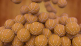 Falling basketball balls against blurred orange background. 3D rendering stock illustration