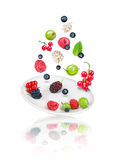 Falling berries on saucer Stock Images