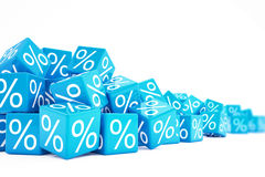 Falling blue cubes with percent signs Stock Images