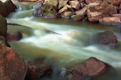 Falling blurred water Royalty Free Stock Photography