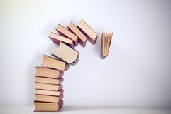 Falling books. On simple background Royalty Free Stock Photos