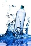 Falling bottle Stock Image
