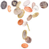 Falling British Coins. Heap of falling british coins isolated on white royalty free stock image