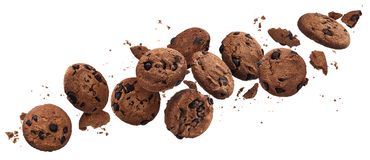 Falling broken chocolate chip cookies isolated on white background with clipping path. Flying biscuits collection royalty free stock photos