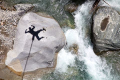 Falling bungee jumper shadow above mountain river Royalty Free Stock Image