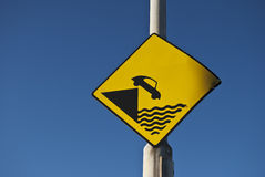 Falling car. Car falling in the water sign with blue sky Royalty Free Stock Photography