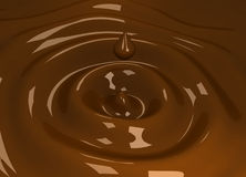 Falling chocolate drop Royalty Free Stock Photography