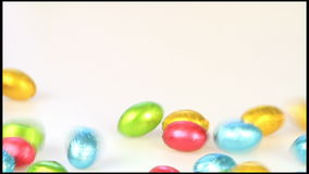 Falling chocolate eggs stock footage