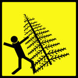 Falling Christmas Tree Warning Sign. A warning sign, making the clear the danger of falling christmas trees, yellow and black isolated.  I created and designed Stock Images