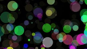 Falling circles in various colors on black stock video footage