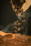 Falling coffee beans Royalty Free Stock Photos