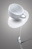 Falling coffee cup Stock Images