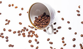 Falling coffee cups and beans Stock Photos