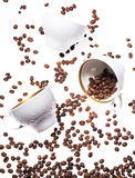 Falling coffee cups and beans Royalty Free Stock Image