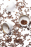 Falling coffee cups and beans Royalty Free Stock Photo