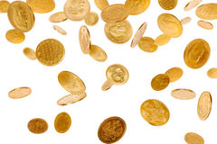 Falling Coins. Old gold coins isolated on white background Royalty Free Stock Photo
