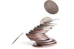 Falling coins. On the white background Royalty Free Stock Photo