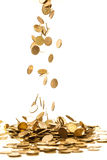 Falling coins. Falling golden coins isolated on white Stock Photos