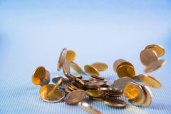 Falling coins money on blue background, business wealth concept. Falling coins money on blue background, business wealth concept idea Royalty Free Stock Photo