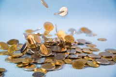 Falling coins money on blue background, business wealth concept. Falling coins money on blue background, business wealth concept idea Royalty Free Stock Photography