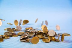 Falling coins money on blue background, business wealth concept. Falling coins money on blue background, business wealth concept idea Stock Photos