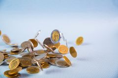 Falling coins money on blue background, business wealth concept. Falling coins money on blue background, business wealth concept idea Royalty Free Stock Images