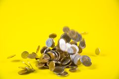 Falling coins money on yellow background, business wealth concep. T idea Stock Photo