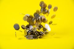 Falling coins money on yellow background, business wealth concep. T idea Royalty Free Stock Photos