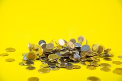 Falling coins money on yellow background, business wealth concep. T idea Stock Photography