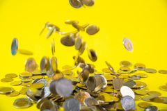 Falling coins money on yellow background, business wealth concep. T idea Royalty Free Stock Image