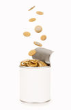 Falling coins in tin Royalty Free Stock Photography