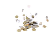 Falling coins on white background Royalty Free Stock Photo