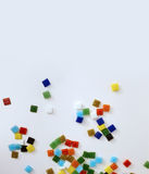 Falling colored glass tiles Royalty Free Stock Photography