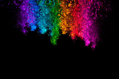 Falling colored powder isolated on black background royalty free stock photos