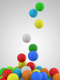 Falling colorful balls 3. Falling colorful balls on grey background Royalty Free Stock Photography
