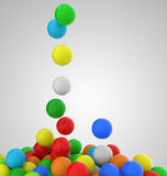 Falling colorful balls. On grey background Stock Photos