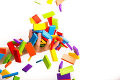 Falling colorful domino Stock Image