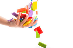 Falling colorful domino Stock Images