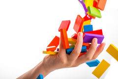 Falling colorful domino Royalty Free Stock Photo