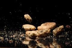 Falling Cookies On Black Background Stock Images