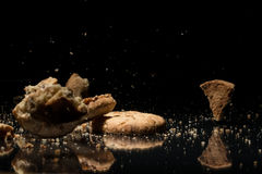 Falling Cookies On Black Background Royalty Free Stock Image