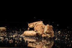 Falling Cookies On Black Background Royalty Free Stock Images