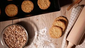 Falling cornflakes. Fresh baked cookies on baking tray.  Dough roll and scattered flour. stock footage