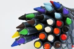 Falling crayons Stock Image