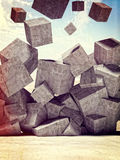 Falling cubes Stock Images