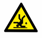 Falling danger sign. Black and yellow danger sign showing a falling person Stock Photos