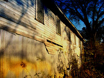 Falling Dark. Deep blue sky with the sun setting on an old barn in the foreground.  Captured near Innovation Park in Tallahassee, FL Royalty Free Stock Photography